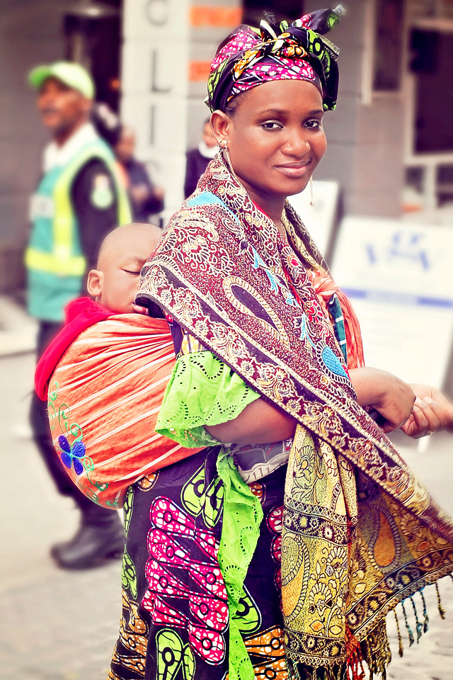 online photo gallery image of woman carrying baby in sling