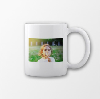Mug with young girl blowing bubbles
